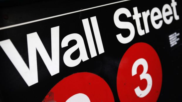 Wall St managed to end level after US Fed talk offset slumping oil prices.