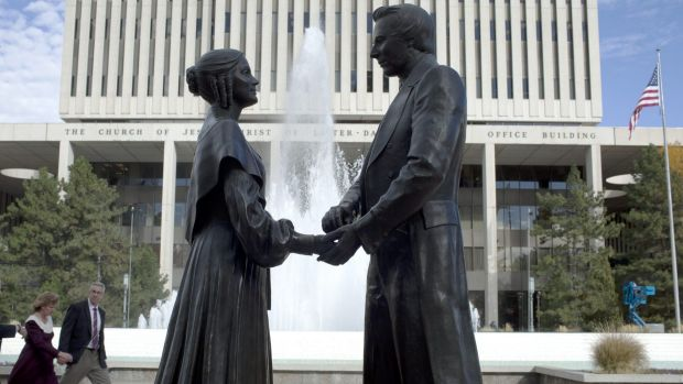 Polygamy strained relations: A statue of the Mormon religion's founder and prophet Joseph Smith with his first wife, ...