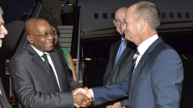 South Africa's president Jacob Zuma is greeted by the Assistant Minister for Defence, Stuart Robert and Queensland's ...