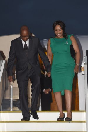 South African President Jacob Zuma and his wife Tobeka Madiba-Zuma arrive at Brisbane Airport.