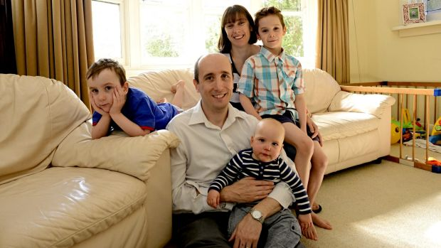 James Canty at home with his family: from left Len, 5, wife Christine with Jack 7 on her knee and 10 month-old Tom.