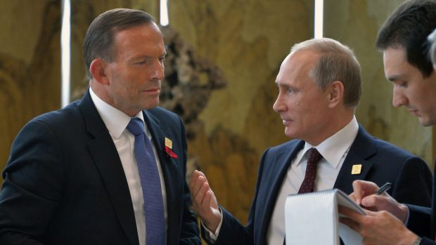 Tony Abbott speaks to Vladimir Putin in Beijing on Tuesday.