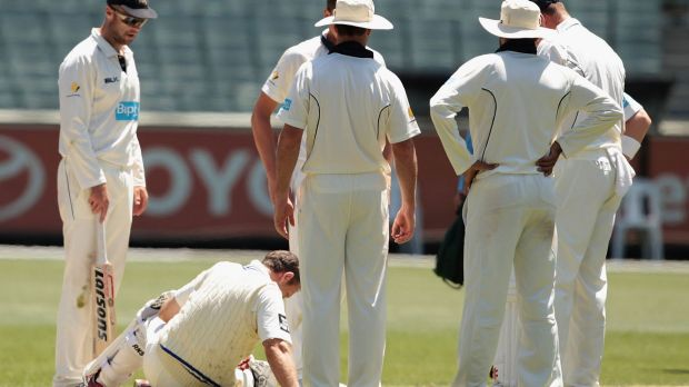 Down for the count: Ben Rohrer lies on the MCG turf after being struck in the head.