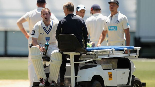Hit for six: A groggy Ben Rohrer is taken from the MCG after being struck during the match against Victoria earlier this ...