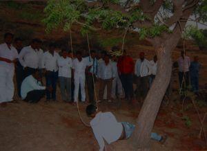 Lynching: Men surround Nitin Aage's body as it hangs from a tree near the central Indian village of Kharda, 330 ...
