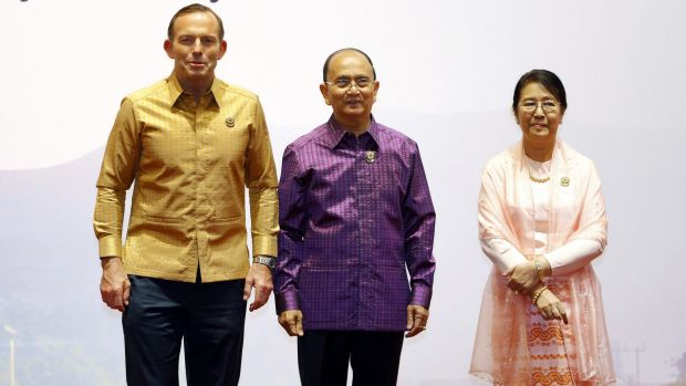 More casual: Tony Abbott is welcomed by Myanmar's President Thein Sein and his wife Khin Khin Win.
