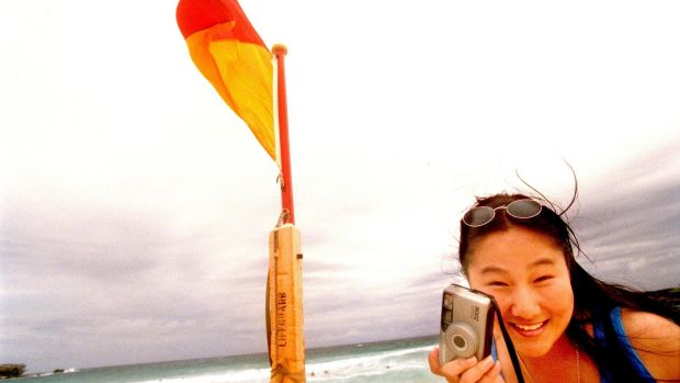 Happy snaps: For those looking to holiday in Australia, Queensland spots such as Airlie Beach and the Gold Coast are ...