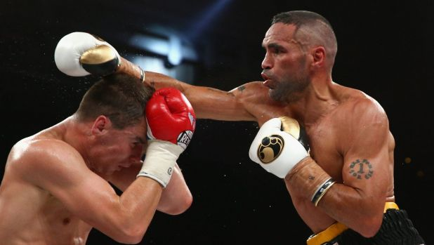 Dishing it out: Anthony Mundine on his way to victory over Sergey Rabchenko.