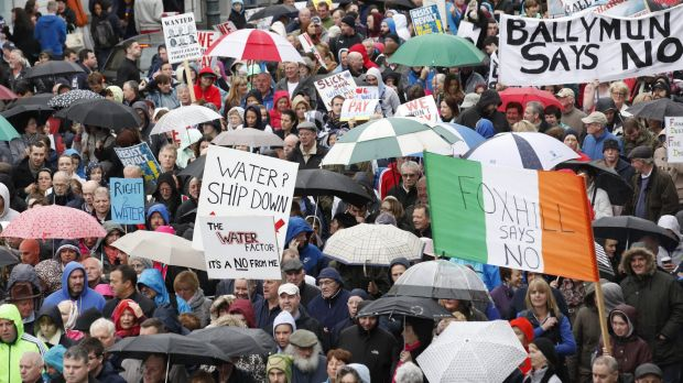 Damp reception: Protesters march against Ireland's new tax on water earlier this month.