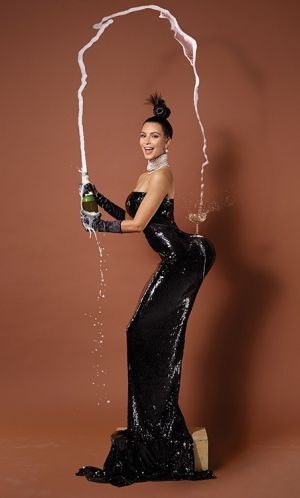 Top shelf: Kim Kardashian recreates Jean-Paul Goude's famous 'Carolina Beaumont, New York, 1976' image for Paper magazine.