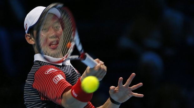 Kei Nishikori hits a return during his victory over David Ferrer.