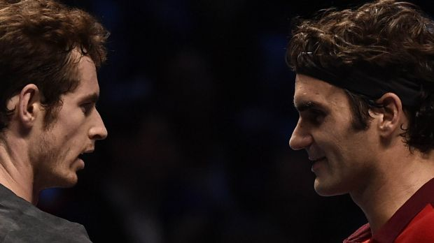 Roger Federer and Andy Murray meet at the net post-match.