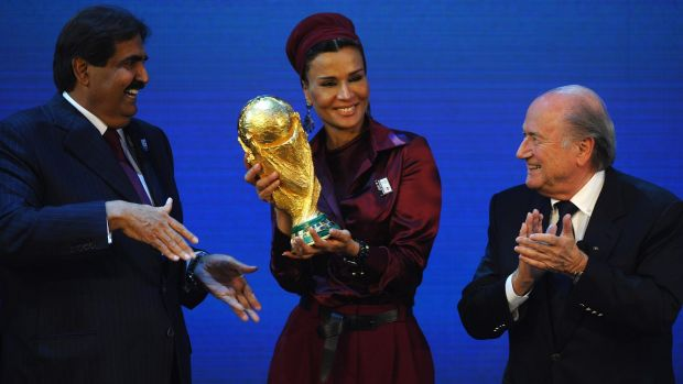 Sheikh Hamad bin Khalifa Al-Thani and Sheikha Mozah bint Nasser Al Missned are presented with the World Cup Tophy by ...