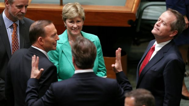 Political leaders greet British PM David Cameron in the House of Representatives after his address.