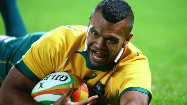 Kurtley Beale slides in for a try for Australia during a rugby test match against France in Brisbane.