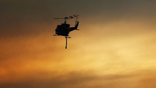 Helicopters carry water as part of reduction drops in Warrimoo.