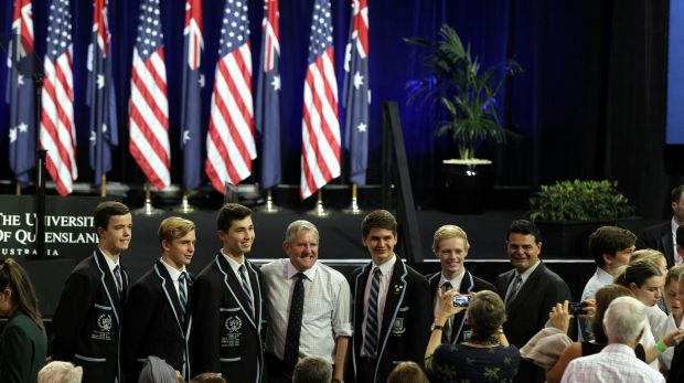 Industry Minister Ian Macfarlane poses for photos with students ahead of US President Barack Obama's speech at the ...