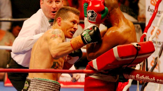 On the ropes: Danny Green takes Roy Jones Jr apart in 2009.