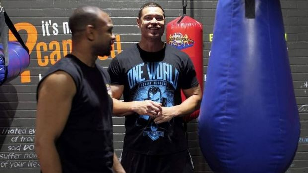 Motivating: Timana Tahu watches as boxing legend Roy Jones Jr leads a boxing class at One World Boxing Academy.