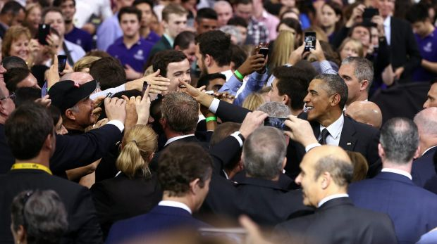 US President Barack Obama greets people after delivering his speech at the University of Queensland.
