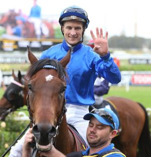 To the four: Blake Shinn celebrates after his fourth win at Rosehill on Saturday.