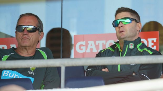 Team doctor Peter Brukner sits with skipper Michael Clarke.