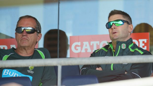 Time out: Michael Clarke, right, watches the one-day game between Australia and South Africa on Friday with team doctor ...