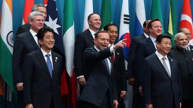 """Prime Minister Tony Abbott poses with the G20 leaders for the """"family"""" photo in Brisbane."""