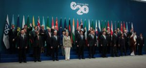"""Leaders line up for the G20 """"family"""" photo."""