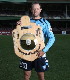 No substitute for the real thing: NSW cricketer Ben Rohrer displays the poor cousin of the Sheffield Shield.