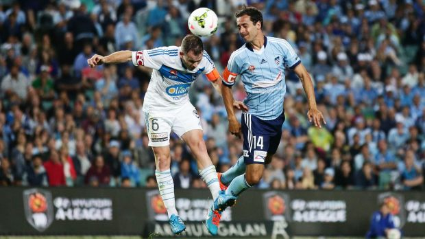 Evenly split: Alex Brosque of Sydney FC competes for the ball against Leigh Broxham of Melbourne Victory.