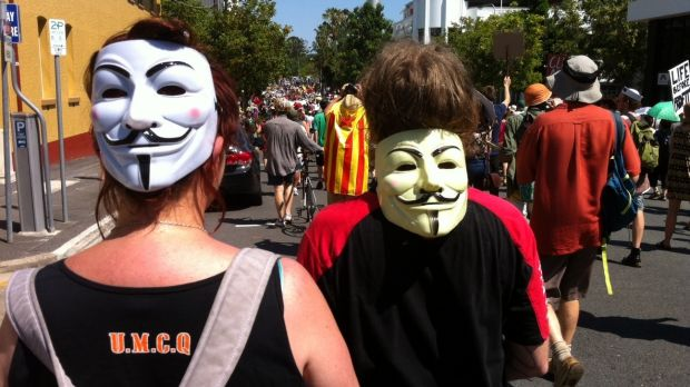 Protesters wearing Guy Fawkes masks take to the streets during G20 in Brisbane.