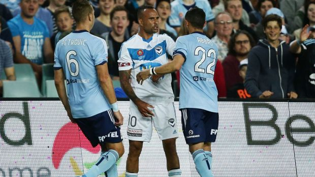 Eventful night: Archie Thompson and Ali Abbas exchange words during the match.