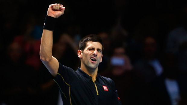 Novak Djokovic celebrates beating Kei Nishikori.