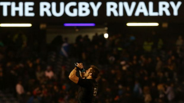 Narrow escape: Richie McCaw leaves the pitch after his team's victory over Scotland.