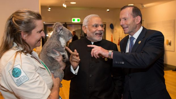 Indian Prime Minister Narendra Modi (pictured meeting a koala with Tony Abbott) will hold talks with Queensland Premier ...