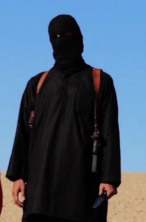 """The masked executioner: It is believed """"Jihad John"""" has been injured  in a US air strike."""