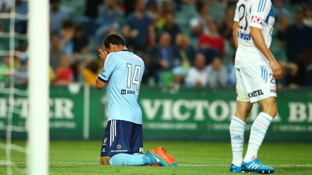 Sydney FC captain Alex Brosque reacts after missing a goal against Melbourne Victory on Saturday night.