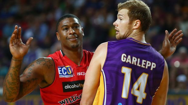 Bad blood: The Wildcats' Earnest Ross and Tom Garlepp of the Sydney Kings size each other up.