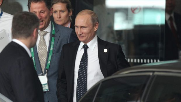 Early departure: Vladimir Putin heads back to Russia.