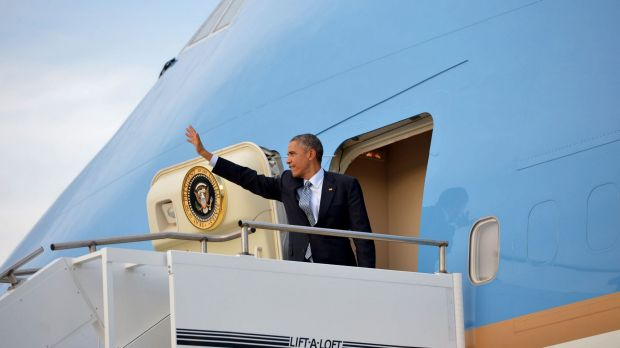 US President Barack Obama waves before boarding Air Force One at Amberley.