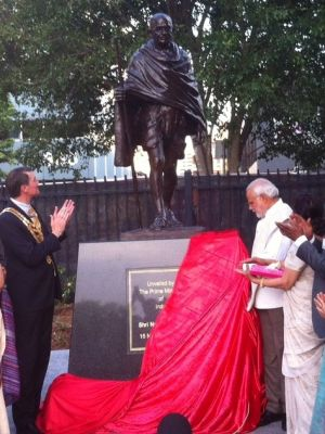 Indian Prime Minister Narendra Modi and Brisbane Lord Mayor Graham Quirk unveil a statue for Mahatma Gandhi in Brisbane.