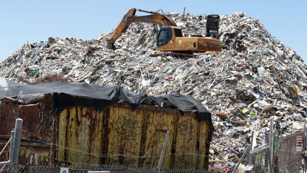 Going to waste: Refuse from the abandoned Skippy Bins depot is to be used to cover contaminated Mr Fluffy material.