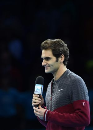 Injured: Roger Federer apologises to the crowd for having to withdraw from the final.