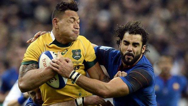 Flat performance: Israel Folau is tackled by the French defence.