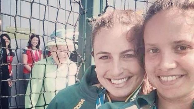 Hockeyroo stars Jayde Taylor and Brooke Peris take a selfie which the Queen photo bombed.