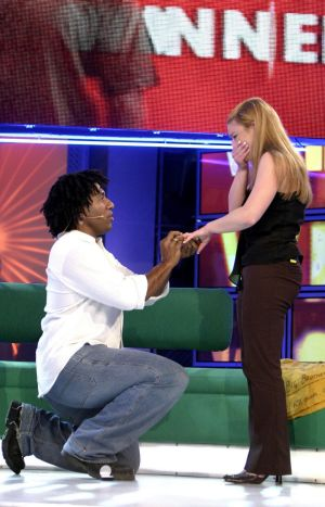 Engaging: Winner Trevor Butler pocketed $1 million then proposed to girlfriend Breea.