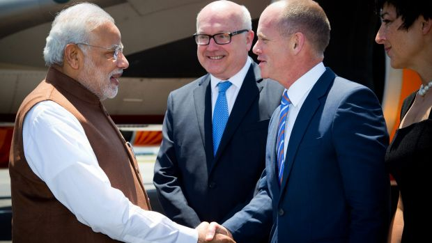 Prime Minister of India Narendra Modi, left, is welcomed by Queensland's Premier Campbell Newman, right, as Australia's ...