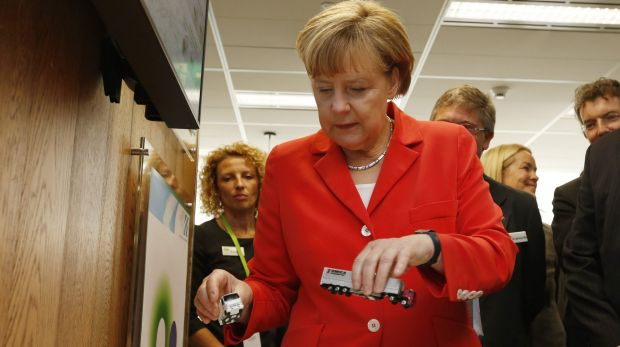 Ms Merkel with model trucks at the research facility.