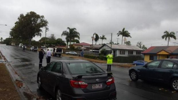 Police cordon off the scene after a man was shot by officers at Kippa Ring.